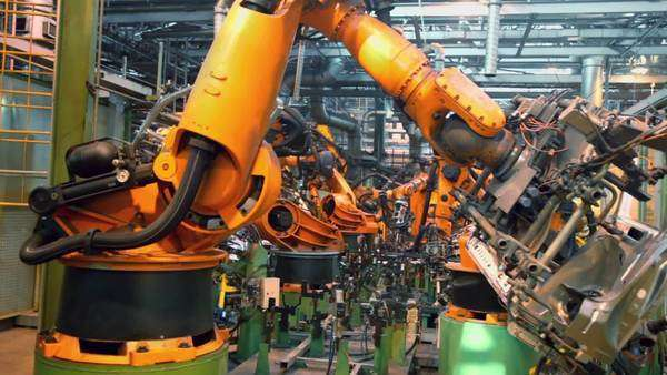 Robots weld car parts in production line at factory Royalty-free stock video