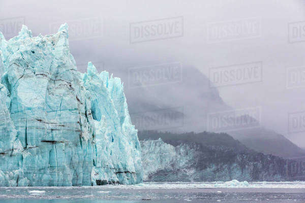 Alaska, Glacier Bay National Park. Margerie Glacier and forested mountain. Royalty-free stock photo
