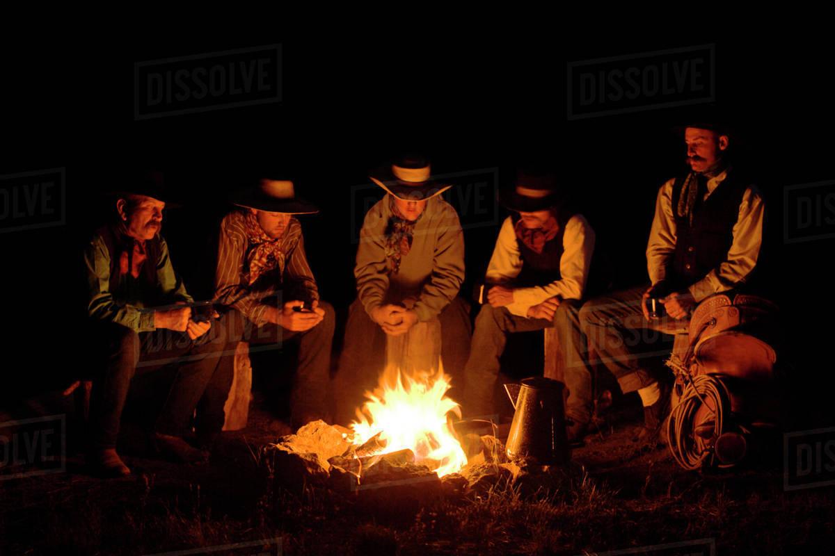 usa oregon seneca ponderosa ranch five cowboys sitting around a
