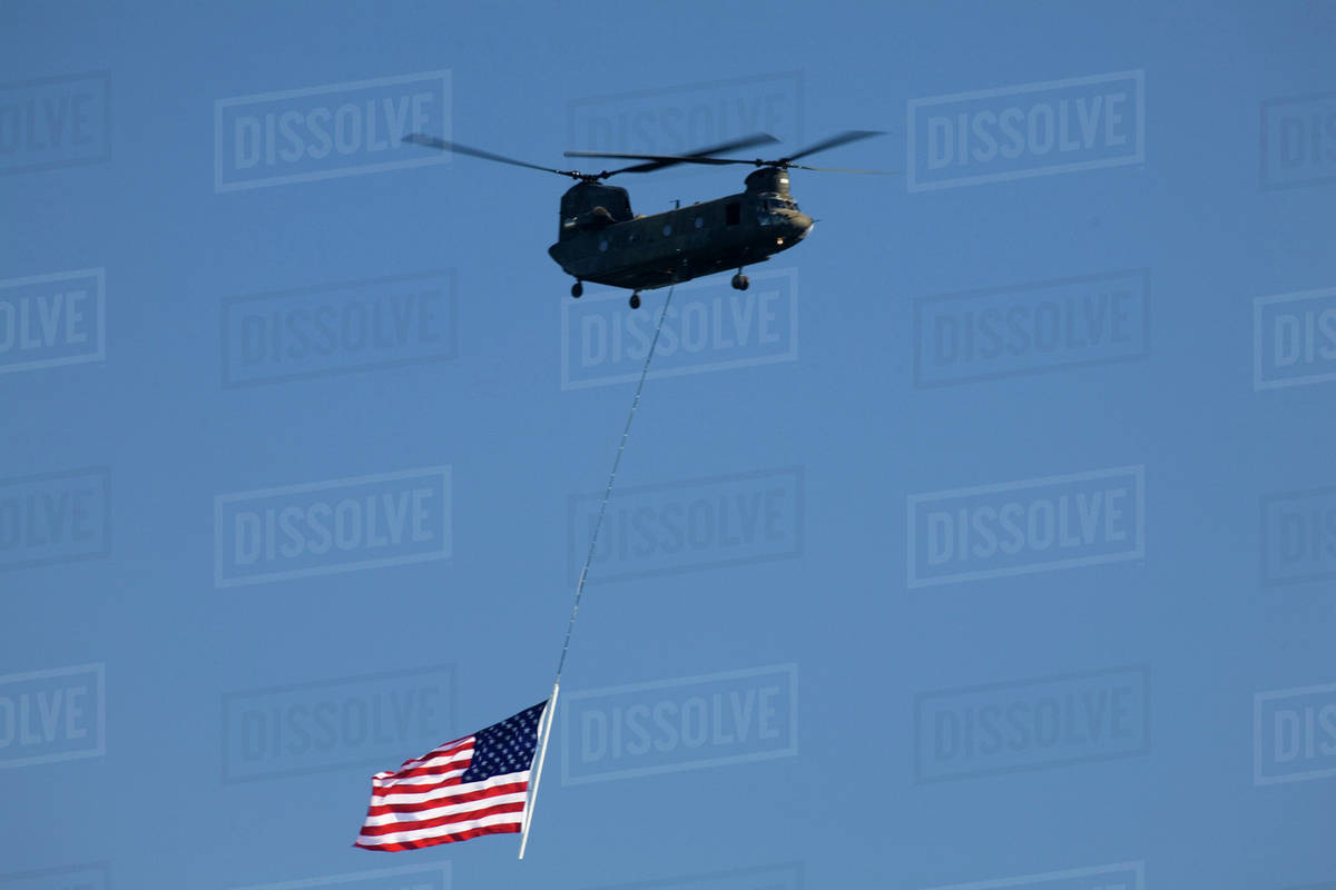 WA, Seattle, Boeing Chinook Helicopter with American Flag, at SEAFAIR stock  photo