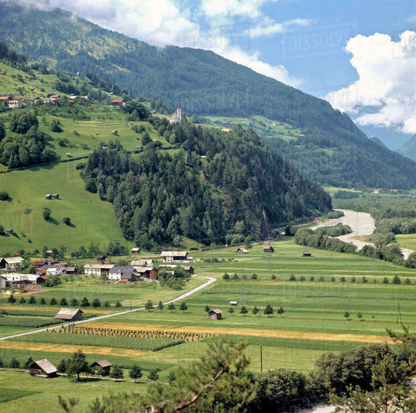 Europe, Austria, Inn River Valley. Neat farms show an abundant harvest outside a village in the Inn River Valley in Austria. Royalty-free stock photo