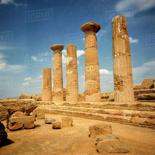 Italy, Sicily, Agrigento. The ruins of the Temple of Hercules rise mightily against a summer sky at Agrigento, a World Heritage Site, in Sicily, Italy. Royalty-free stock photo
