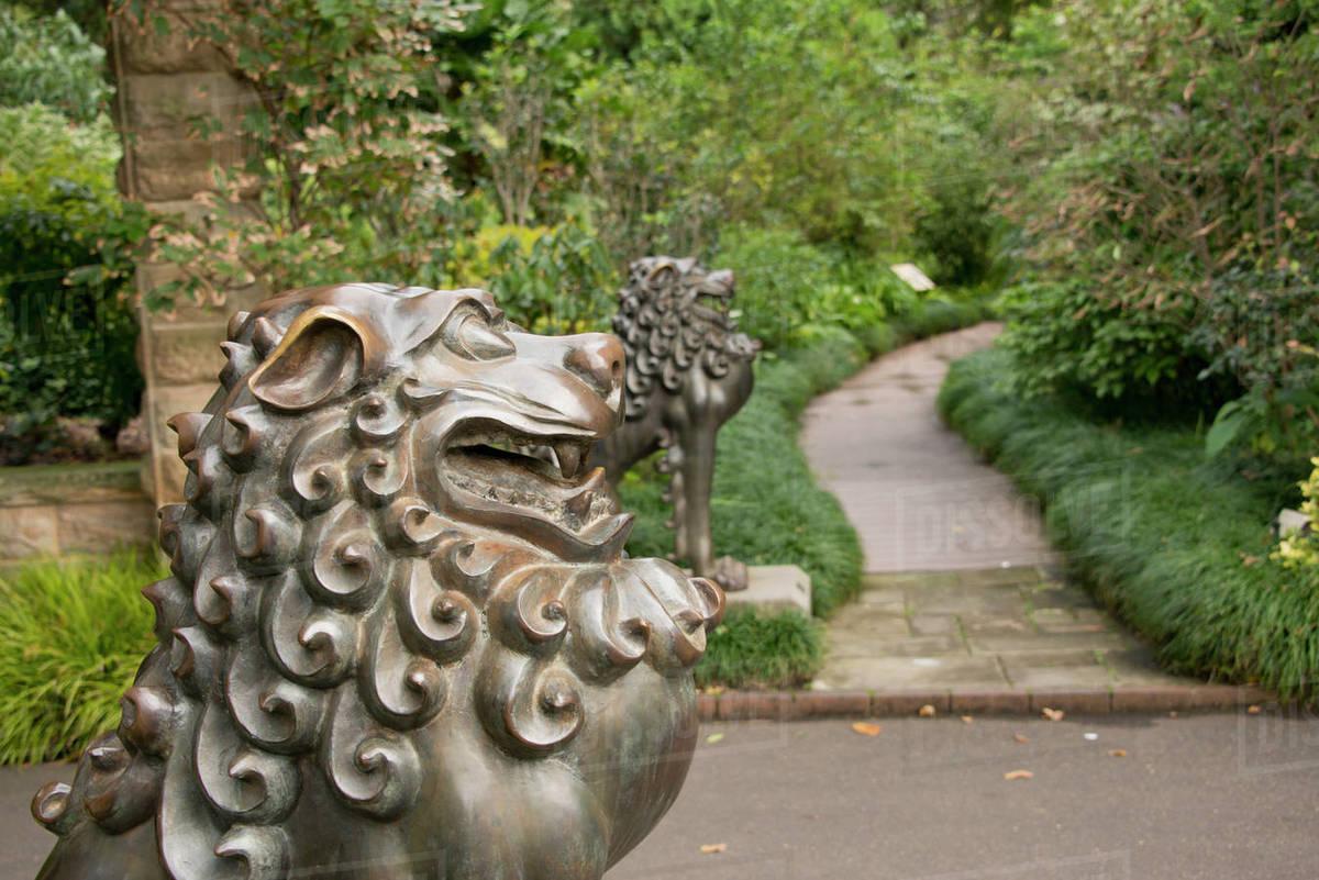 Australia, Sydney, Royal Botanic Gardens. Mythological Lion Statue In Front  Of Garden Path.