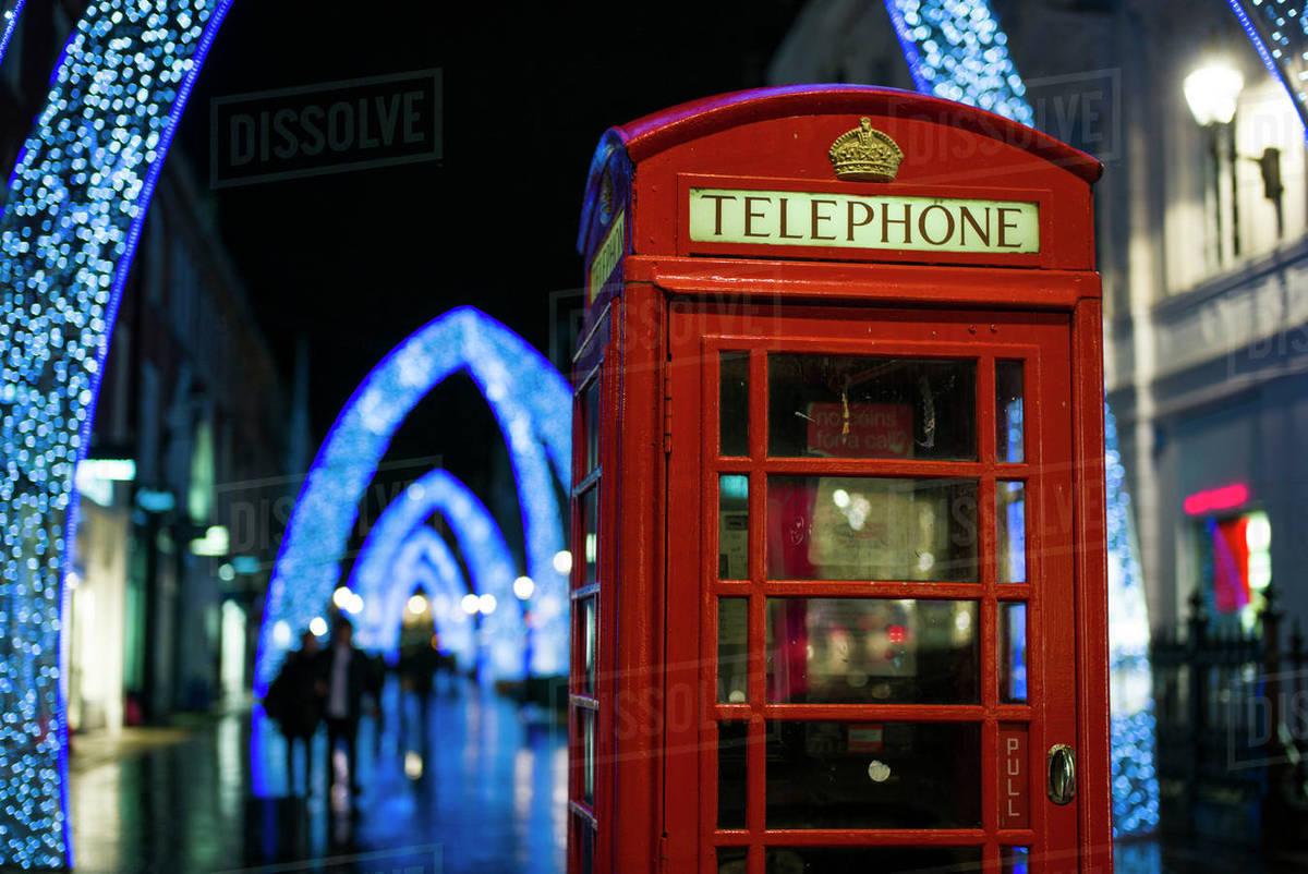 England Christmas Decorations.England London Soho English Telephone Box And Christmas Decorations Stock Photo