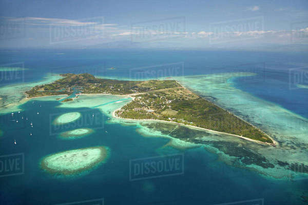 Coral reef and Malolo Lailai Island, Mamanuca Islands, Fiji, South Pacific, aerial Rights-managed stock photo
