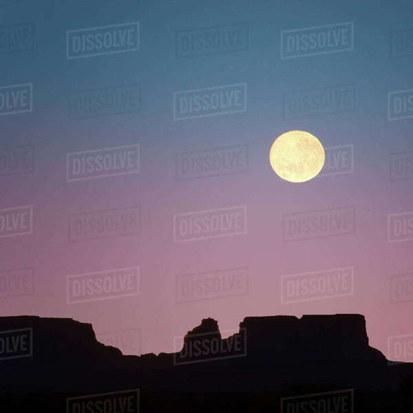 USA, Arizona. Moonrise over butte. Rights-managed stock photo