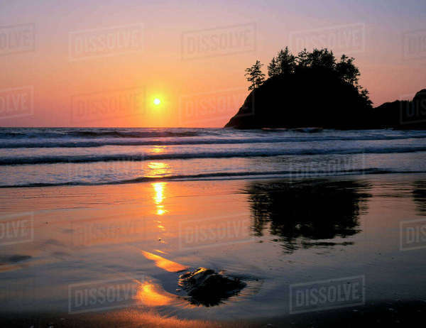 Trinidad State Beach, California. USA. Sea stack & setting sun. Pacific Ocean. Rights-managed stock photo