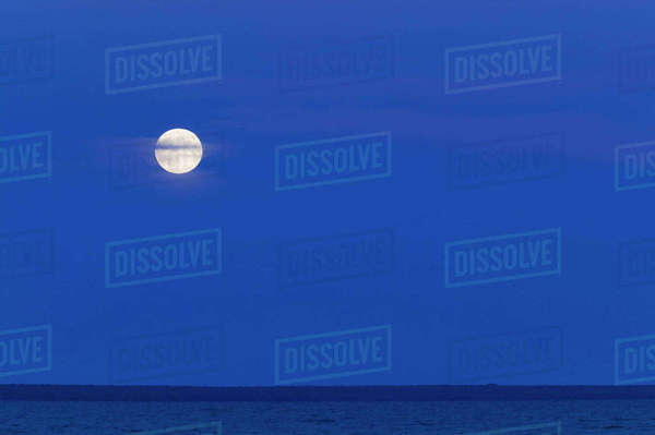 USA, Michigan, Straits of Mackinac: Mackinaw City, Full Moonrise over the Straits of Mackinac between Lakes Michigan and Huron Rights-managed stock photo