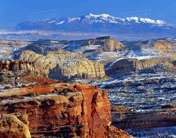 Capitol Reef National Park, Utah. USA. Snow on sandstone domes of Capitol Reef. Henry Mountains in the distance. View from East Rim. Colorado Plateau. Rights-managed stock photo