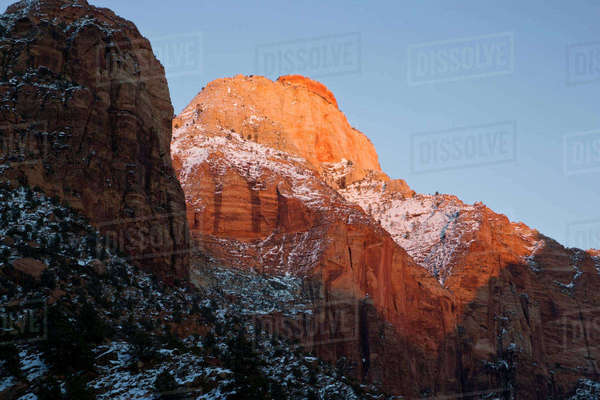 Zion National Park, Utah. USA. Light of winter sunset on East Temple. Zion Canyon. Rights-managed stock photo