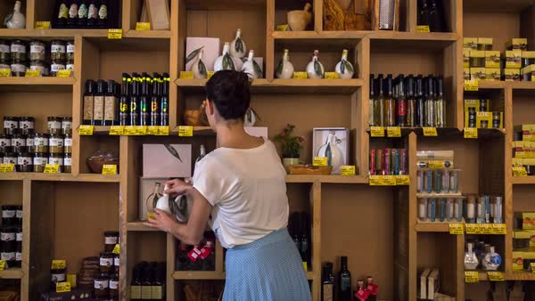 MS Woman arranging bottles in restaurant's shop Royalty-free stock video
