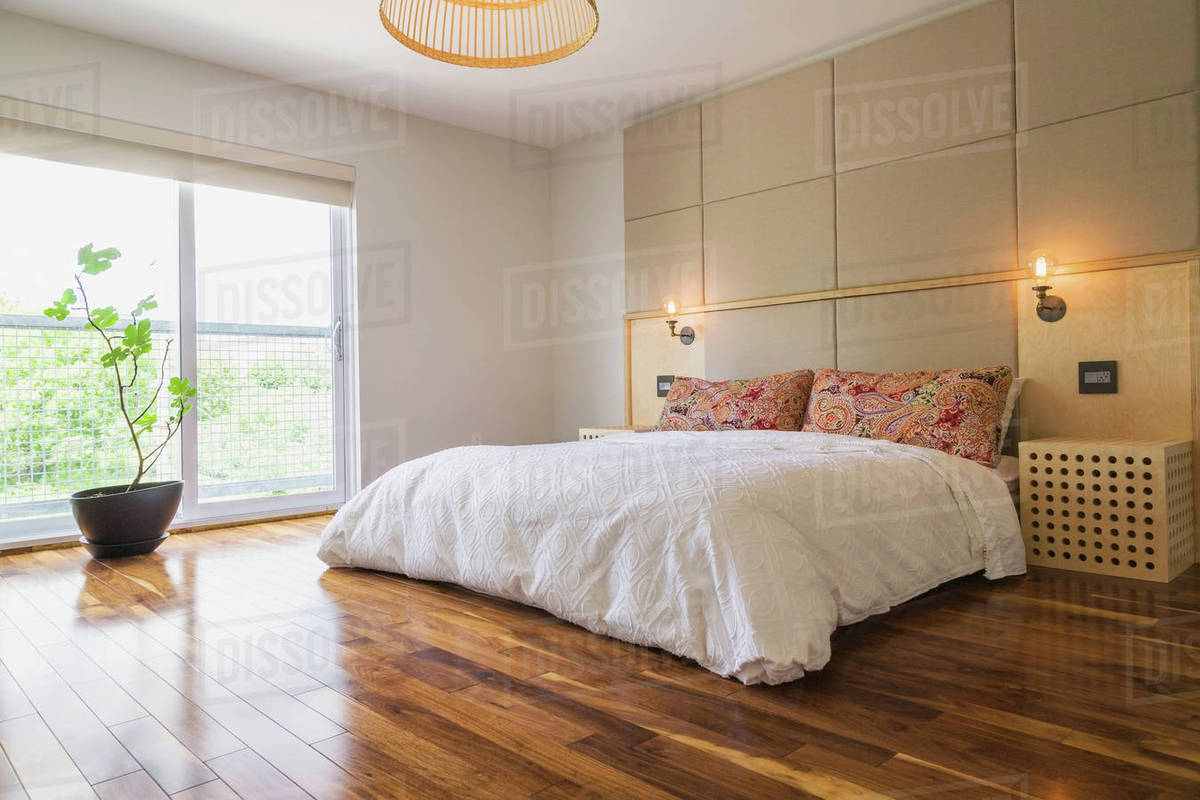 King Size Bed In Bedroom With American Walnut Hardwood Flooring On