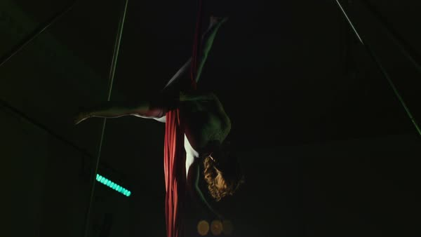 Young woman performing windmill move on aerial silk Royalty-free stock video