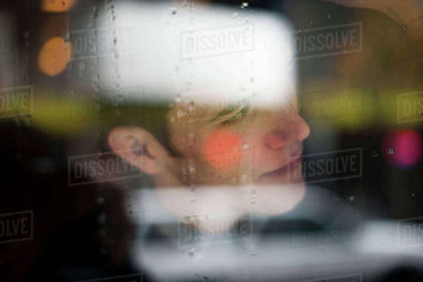 Man viewed through wet glass Royalty-free stock photo
