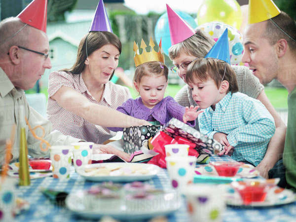Girl with family at birthday party Royalty-free stock photo