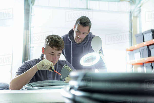 Apprentice and electrical engineer mentor in cable finishing factory Royalty-free stock photo