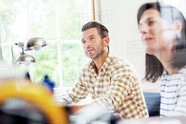 Two  designers having meeting at desk in creative studio Royalty-free stock photo