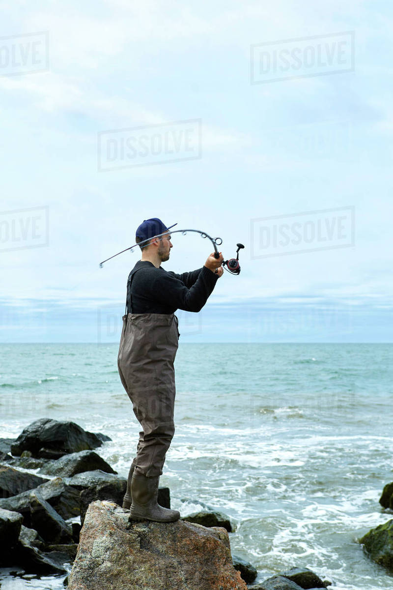 A man with a fishing rod 31