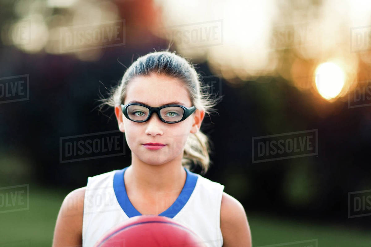 a619b5781e Portrait of girl wearing sports goggles holding basketball - Stock ...
