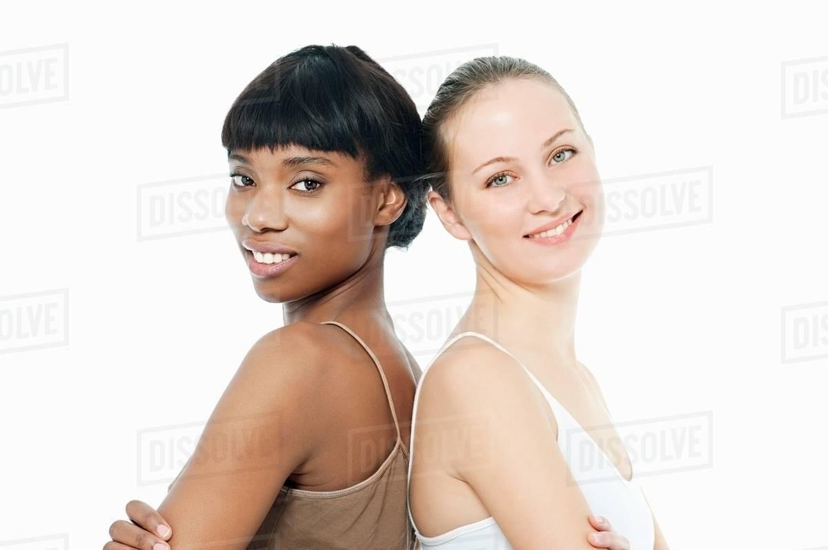 dc4298e98e Two young women back to back - Stock Photo - Dissolve