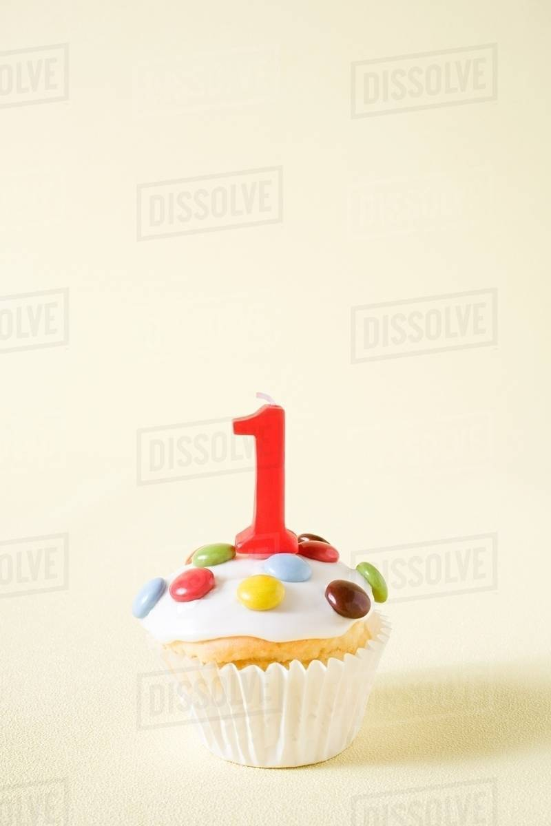 Cupcake With Number One Candle Stock Photo Dissolve