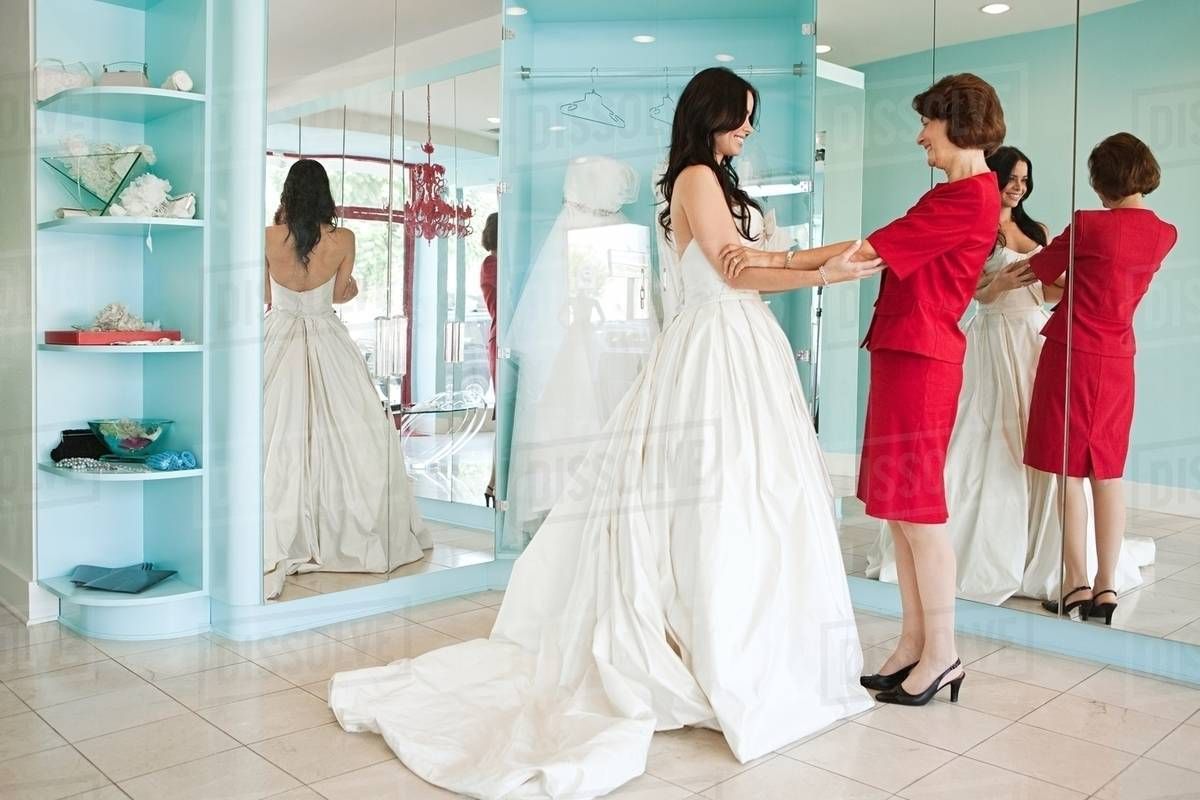 Daughter Trying On Wedding Dress Holding Hands D25 40 503