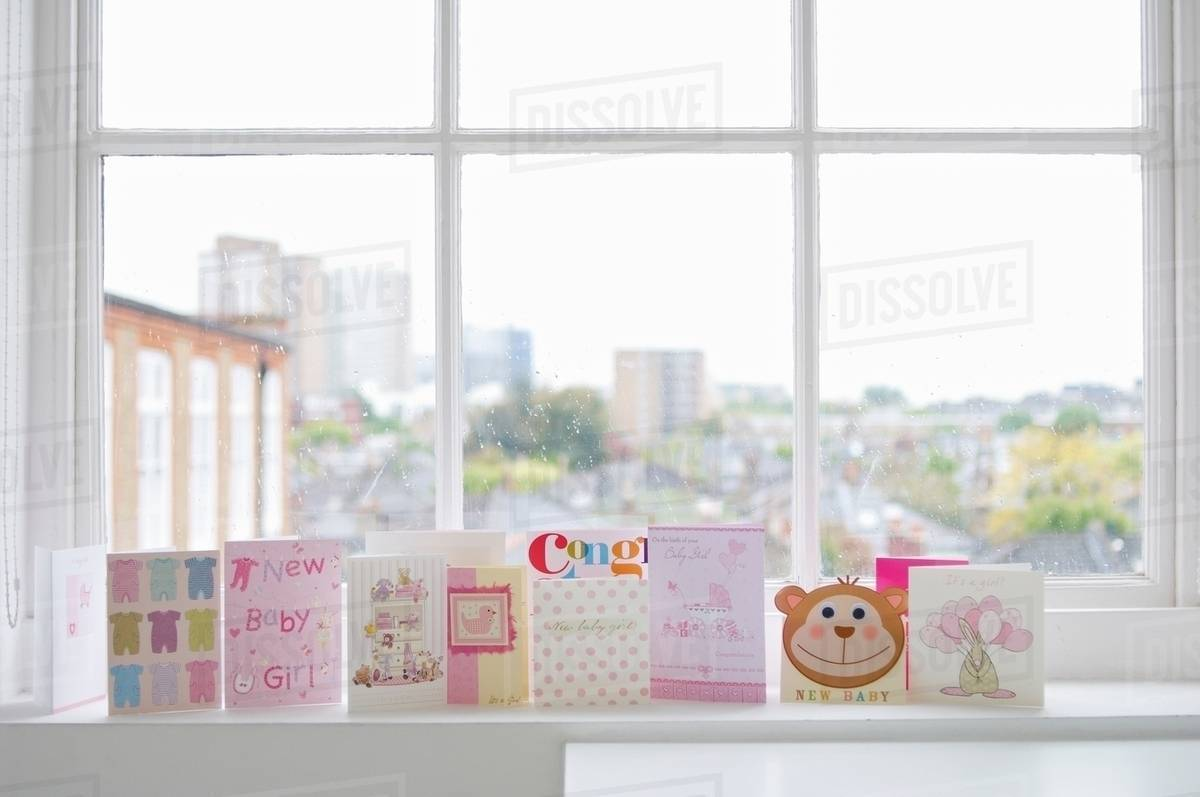 Greetings Cards For New Baby Girl On Windowsill Stock Photo Dissolve