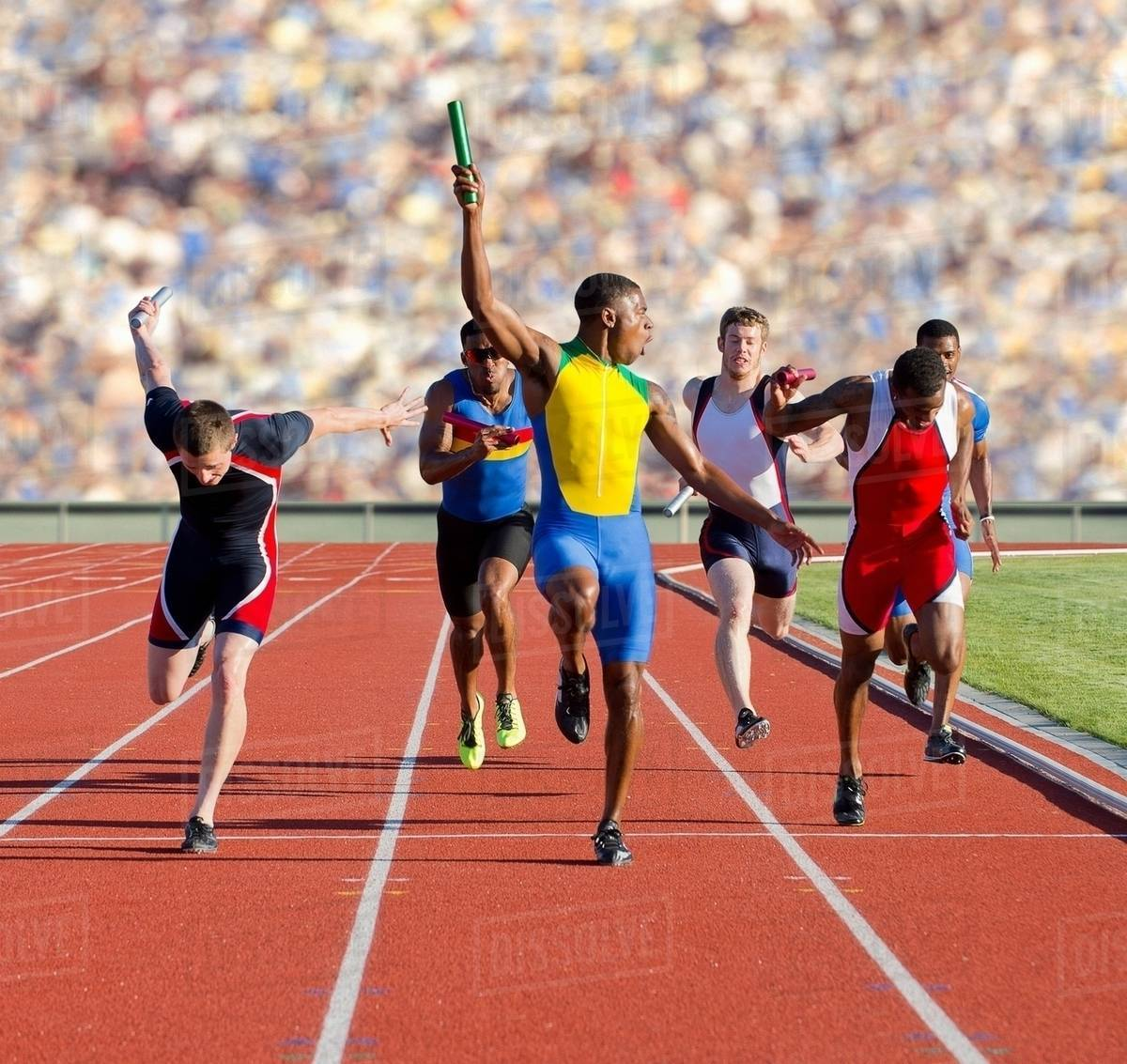 Six Athletes Running Relay Race - Stock Photo