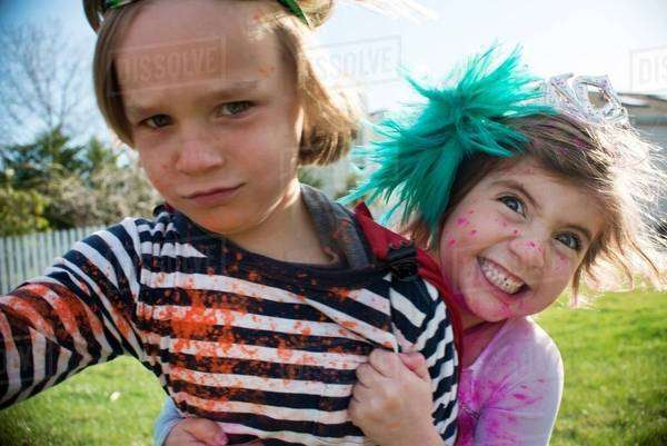 Children in costumes playing outdoors Royalty-free stock photo