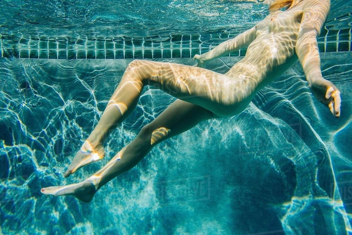 Underwater Side View Of Nude Young Woman In Swimming Pool -2574