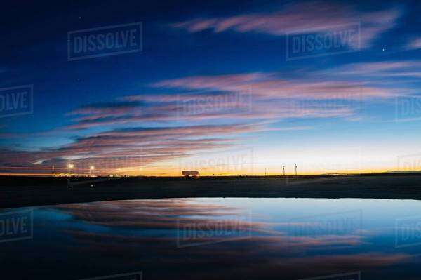 Reflection pool of dramatic evening sky and buildings illuminated by street light, Bonneville, Utah, USA Royalty-free stock photo