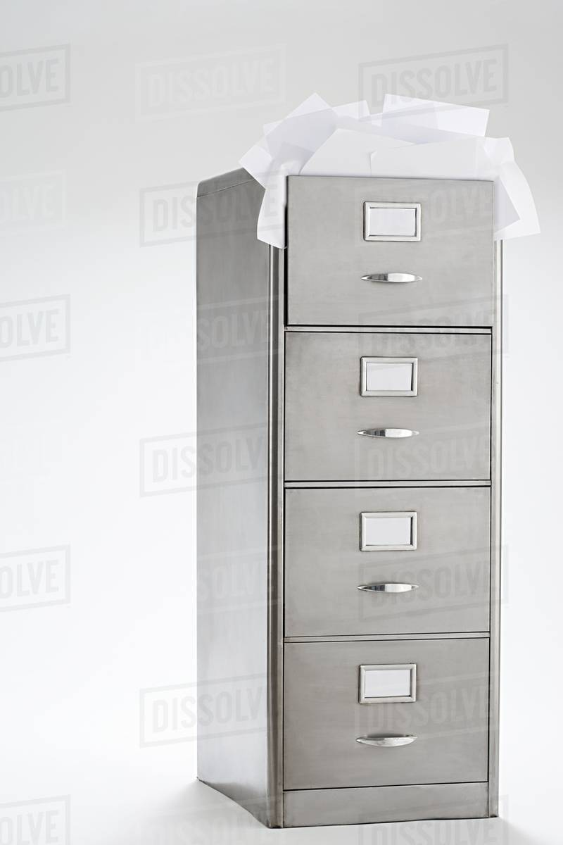 paper in filing cabinet - stock photo - dissolve paper filing cabinet