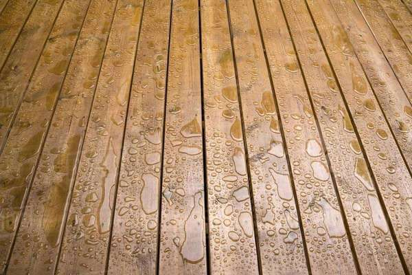 Wooden patio deck surface with water repellant stain applied Royalty-free stock photo