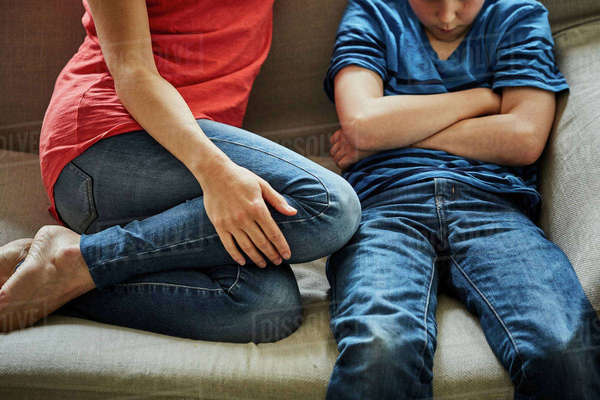 Mother on sofa scolding son Royalty-free stock photo