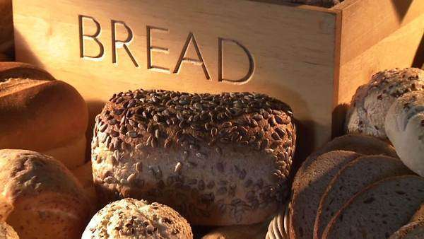 Bread bin and various types of bread and bread rolls Royalty-free stock video