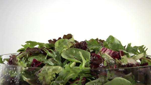 Sprinkling mixed salad leaves with cheese Royalty-free stock video