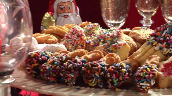 Plate of biscuits, candy canes and Chocolate Father Christmases Royalty-free stock video