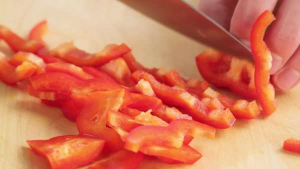 Red and yellow peppers being sliced Rights-managed stock video