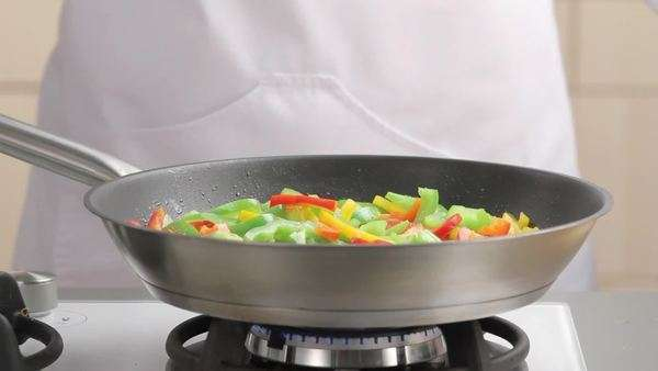 Pepper strips being fried in a pan Rights-managed stock video