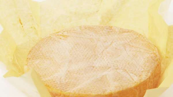 Red washed rind cheese with paper Royalty-free stock video