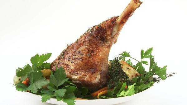Roast lamb shank with herbs and vegetables Royalty-free stock video