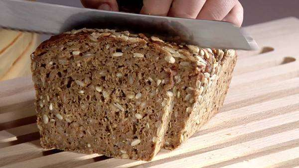 Slicing sunflower seed bread Royalty-free stock video
