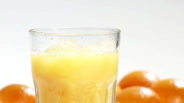 Pouring orange juice into a glass of crushed ice (close-up) Royalty-free stock video