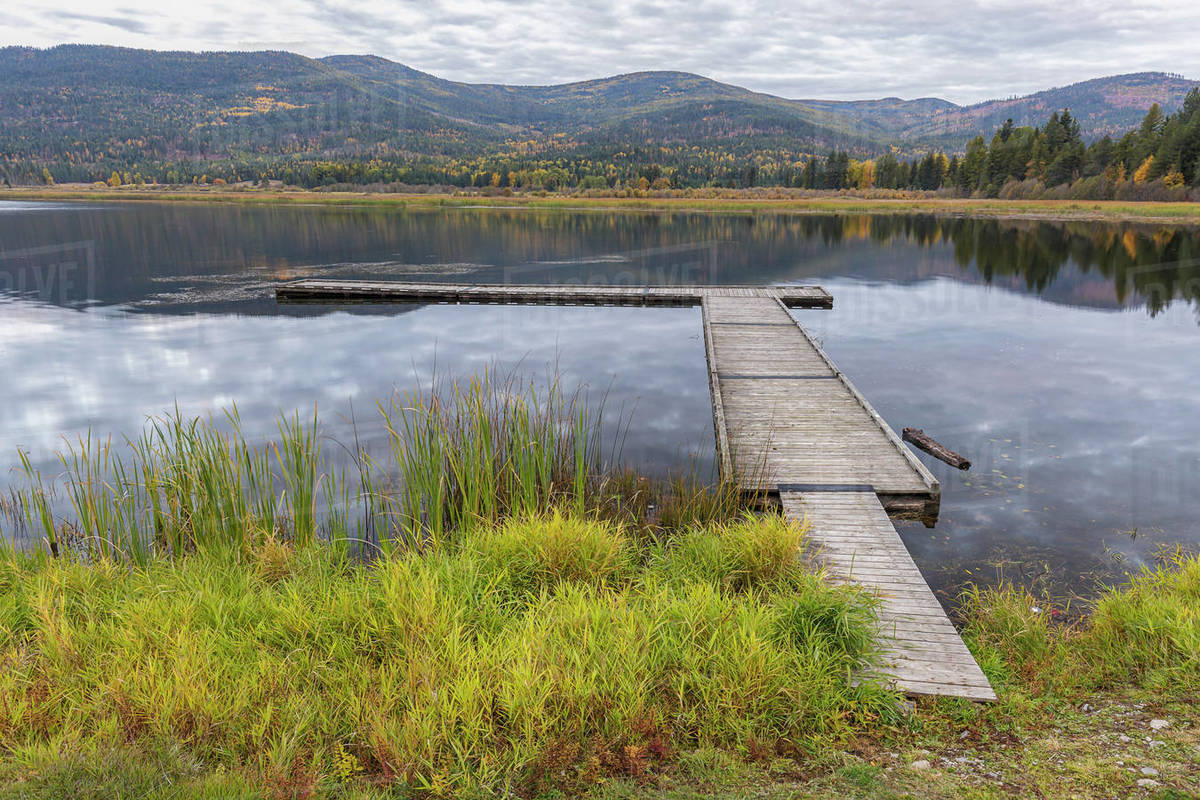 Looking out at the dockon the calm McArthur Lake in north Idaho Royalty-free stock photo
