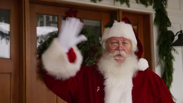 Santa Claus waving by front door Royalty-free stock video
