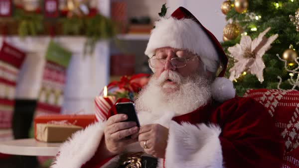 Santa Claus texting with cell phone and taking selfie Royalty-free stock video