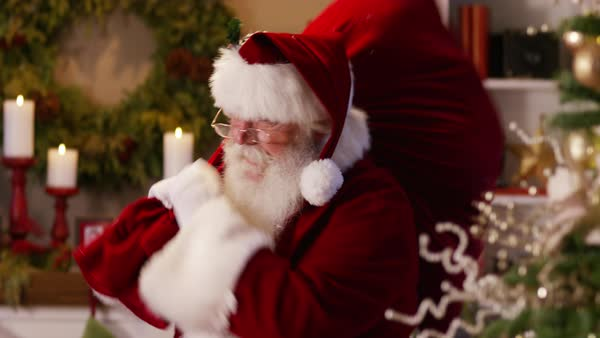 "Santa Claus waves and says ""Merry Christmas"", Closeup Royalty-free stock video"