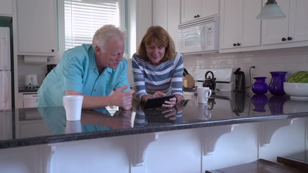 Senior couple using digital tablet together Royalty-free stock video