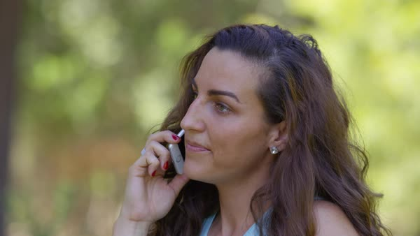 Woman outdoors talking on cell phone Royalty-free stock video