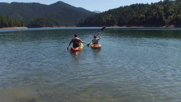 Couple kayaking on lake Royalty-free stock video
